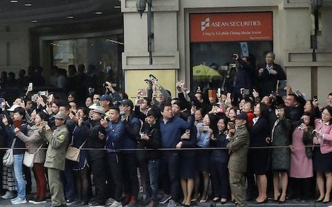 <span>Kim Jong-un's motorcade was greeted by crowds lining the streets of Hanoi</span>