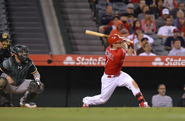 Los Angeles Angels' Collin Cowgill, right, hits a home run to win the game as Oakland Athletics catcher Derek Norris looks on in the 14th inning of a baseball game, Tuesday, June 10, 2014, in Anaheim, Calif. (AP Photo/Mark J. Terrill)