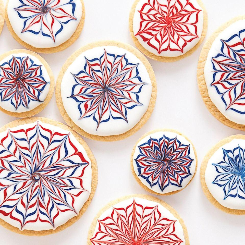 """<p>Put on a show with the help of these red, white, and blue iced sugar cookies. </p><p><strong><em>Get the recipe for <a href=""""https://www.delish.com/cooking/recipe-ideas/recipes/a20781/fireworks-cookies-recipe-mslo0613/"""" rel=""""nofollow noopener"""" target=""""_blank"""" data-ylk=""""slk:Fireworks Cookies"""" class=""""link rapid-noclick-resp"""">Fireworks Cookies</a>. </em></strong></p>"""