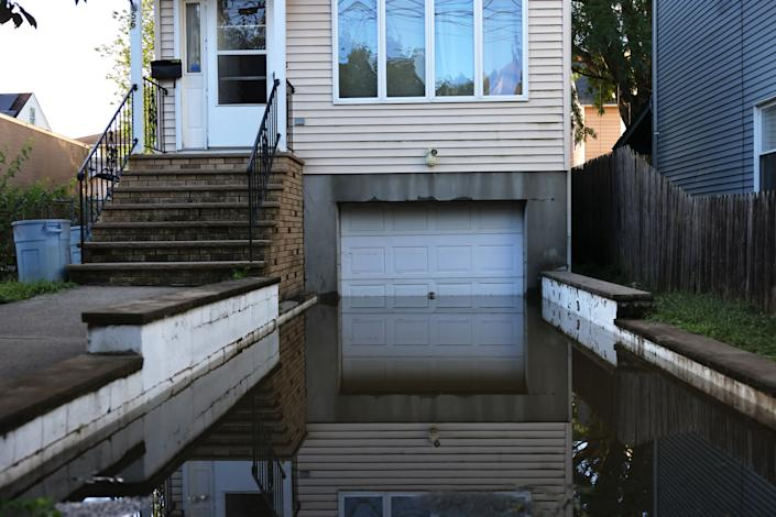 Floodwaters lead into a garage in Passaic City, N.J., on Thursday.