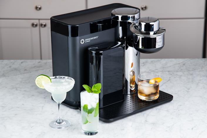 """<em>For the mixologist mom:</em><br><span><h2>Drinkworks Home Bar by Keurig</h2></span>Between now and May 10, Drinkworks is offering $100 off its home bar device. The all-in-one device can prepare over two dozen different types of cocktails (with drink pods sold separately) with the push of a single button. Pretty handy, given that it doesn't look like we'll be going out to bars anytime soon. <br><br><strong>Drinkworks</strong> Drinkworks Home Bar by Keurig®, $, available at <a href=""""https://go.skimresources.com/?id=30283X879131&url=https%3A%2F%2Fwww.drinkworks.com%2F%3Futm_source%3Dweb%26utm_medium%3Dweb%26utm_campaign%3Dmday"""" rel=""""nofollow noopener"""" target=""""_blank"""" data-ylk=""""slk:Drinkworks"""" class=""""link rapid-noclick-resp"""">Drinkworks</a>"""