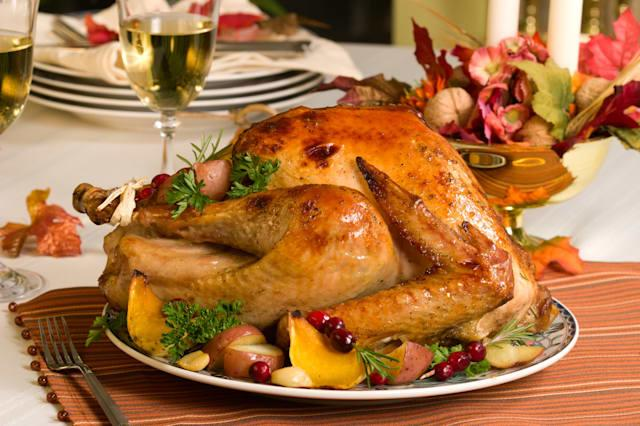 Feasting backed turkey on holiday table ready to eat