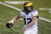 Michigan's Cade McNamara throws a pass during the second half of an NCAA college football game against Rutgers on Saturday, Nov. 21, 2020, in Piscataway, N.J. Michigan won 48-42. (AP Photo/Frank Franklin II)