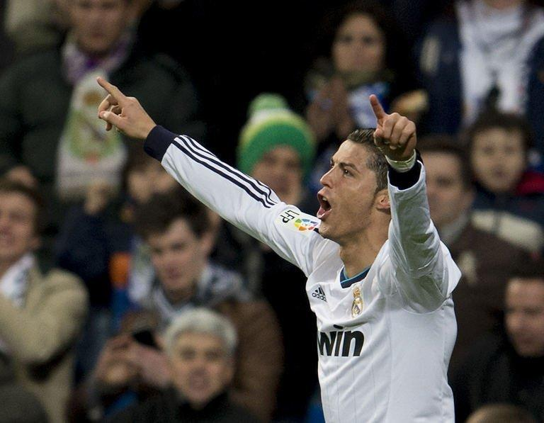 Real Madrid's Cristiano Ronaldo celebrates after scoring against Sevilla on February 9, 2013