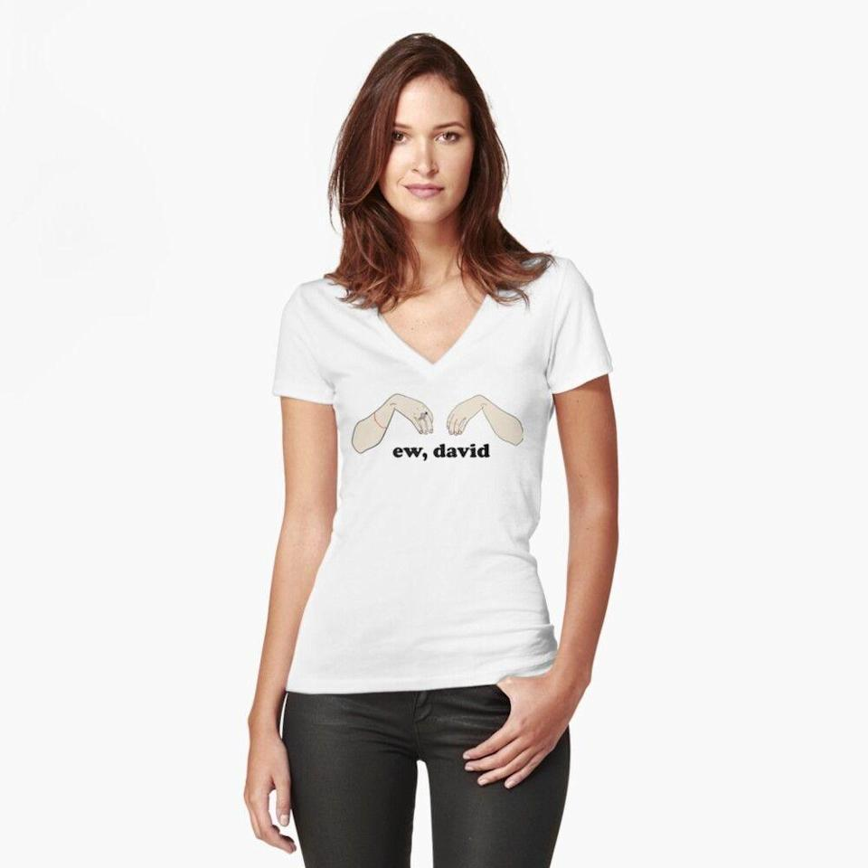 """<p>redbubble.com</p><p><strong>$22.16</strong></p><p><a href=""""https://go.redirectingat.com?id=74968X1596630&url=https%3A%2F%2Fwww.redbubble.com%2Fi%2Ft-shirt%2FEw-David-Schitt-s-Creek-by-saracrump%2F41195698.UIV3X&sref=https%3A%2F%2Fwww.redbookmag.com%2Flife%2Fg34832329%2Fbest-schitts-creek-gifts%2F"""" rel=""""nofollow noopener"""" target=""""_blank"""" data-ylk=""""slk:SHOP NOW"""" class=""""link rapid-noclick-resp"""">SHOP NOW</a></p><p>While there is plenty of <a href=""""https://www.amazon.com/s?k=ew+david&ref=nb_sb_noss_2&tag=syn-yahoo-20&ascsubtag=%5Bartid%7C10063.g.34832329%5Bsrc%7Cyahoo-us"""" rel=""""nofollow noopener"""" target=""""_blank"""" data-ylk=""""slk:&quot;Ew, David&quot; merchandise"""" class=""""link rapid-noclick-resp"""">""""Ew, David"""" merchandise</a> out there, nothing captures Alexis's disgust quite like this shirt, which also includes her iconic hand gesture. Just merely looking at this tee, you can hear Alexis screaming at her brother.</p>"""
