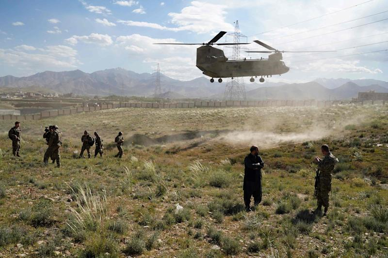 A US military Chinook helicopter lands on a field outside the governor's palace during a visit  the commander of US and NATO forces in Afghanistan, in Maidan Shar, capital of Wardak province: P via Getty Images
