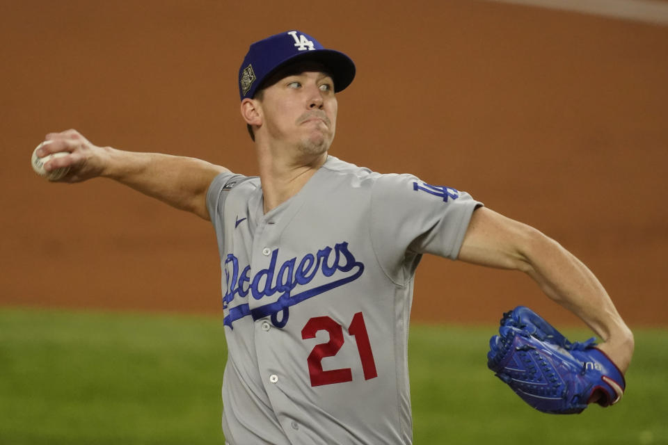 Los Angeles Dodgers starting pitcher Walker Buehler throws against the Tampa Bay Rays during the first inning in Game 3 of the baseball World Series Friday, Oct. 23, 2020, in Arlington, Texas. (AP Photo/Tony Gutierrez)