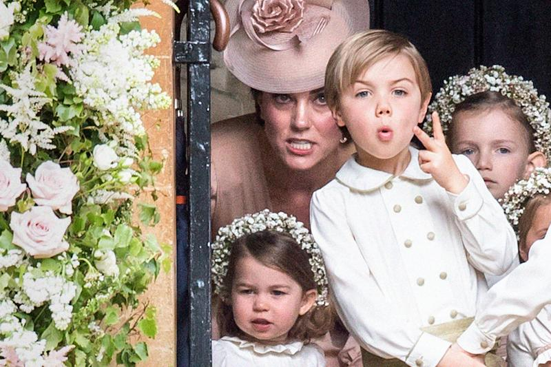 Two fingers: Duchess of Cambridge with Princess Charlotte and a cheeky page boy at her sister's wedding: Samir Hussein