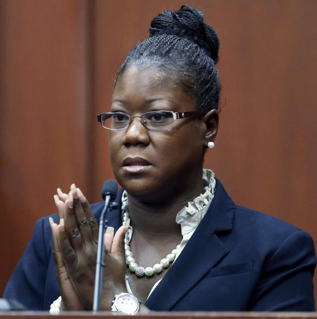 FILE - In a Friday, July 5, 2013, file pool photo, Trayvon Martin's mother, Sybrina Fulton, takes the stand during George Zimmerman's trial in Seminole County circuit court, in Sanford, Fla. Zimmerman's mother and Martin's mother each testified Friday that it was her son, not the other woman's, who can be heard screaming for help on a 911 call. Identifying the voice could be critical to the case because it could help the jury determine who the aggressor was during the scuffle. (AP Photo/Orlando Sentinel, Gary W. Green, Pool, File)