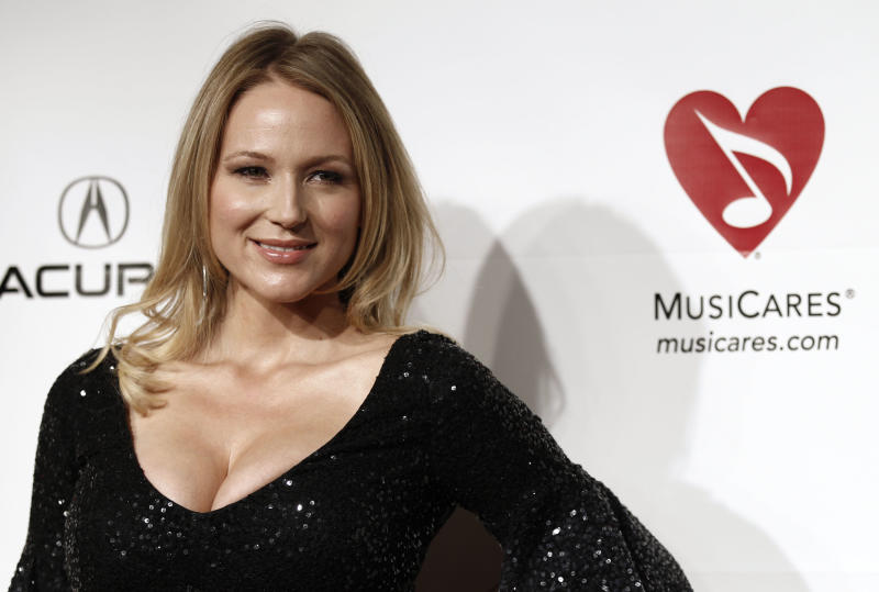 """FILE - In this Feb. 11, 2011 file photo, Jewel arrives at the MusiCares Person of the Year gala honoring Barbra Streisand in Los Angeles. Jewel's latest song, """"Flower,"""" was written to raise awareness about the importance of breast reconstruction options for breast cancer survivors. The singer is heading to New Orleans next month to perform """"Flower"""" and other hits at a benefit concert championing the cause. (AP Photo/Matt Sayles, file)"""
