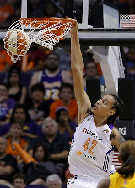 FILE - In this May 27, 2013, file photo, Phoenix Mercury's Brittney Griner gets her first dunk against the Chicago Sky during the second half of a WNBA basketball game in Phoenix. It's been 15 years since Sylvia Crawley won the ABL slam dunk contest with a blindfolded jam. With so many more women who can dunk, including Griner, it may not be long before it becomes part of the WNBA All-Star game weekend. (AP Photo/Ross D. Franklin, File)