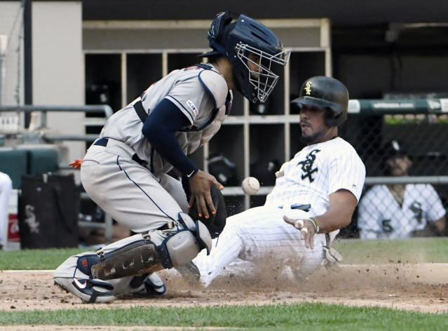 Chicago White Sox's Jose Abreu, right, is safe at home plate as Houston Astros catcher Robinson Chirinos, left, takes a late throw during the fourth inning of game one of a baseball doubleheader, Tuesday, Aug. 13, 2019, in Chicago. (AP Photo/David Banks)