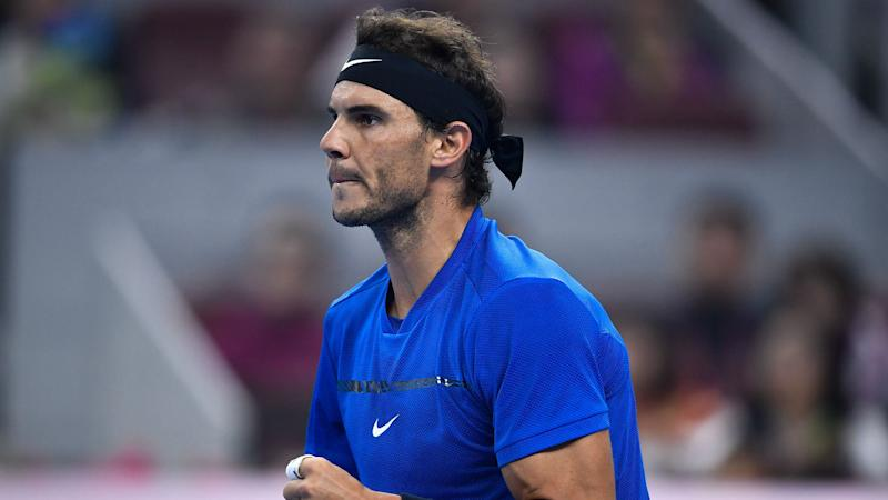 Nadal defies 'tennis ball hair' mishap to sweep into Beijing semis