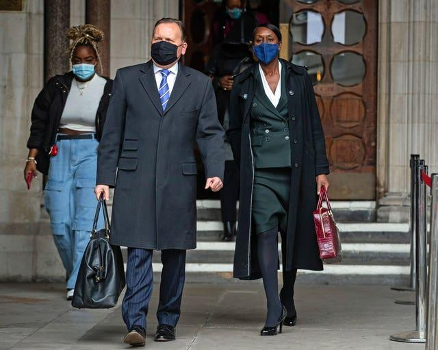 Novlett Robyn Williams leaves the Court of Appeal with Victor Marshall from the Police Superintendents Association