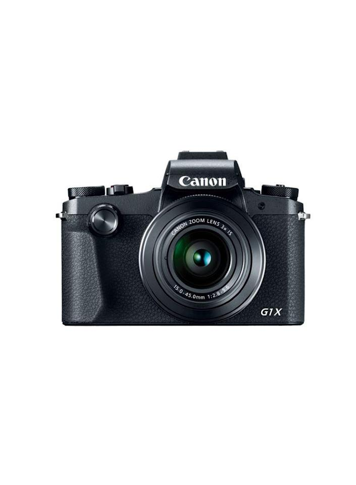 """<p><strong>Canon</strong></p><p>amazon.com</p><p><strong>$999.00</strong></p><p><a href=""""http://www.amazon.com/dp/B076BBL9HL/?tag=syn-yahoo-20&ascsubtag=%5Bartid%7C10067.g.13094996%5Bsrc%7Cyahoo-us"""" rel=""""nofollow noopener"""" target=""""_blank"""" data-ylk=""""slk:Shop Now"""" class=""""link rapid-noclick-resp"""">Shop Now</a></p><p>Serious amateur photographers will appreciate the first compact digital camera from Canon to feature a large 24.2-megapixel APS-C sensor and a Dual Pixel CMOS AF system, which offers incredibly quick autofocus—even for subjects in motion.</p>"""