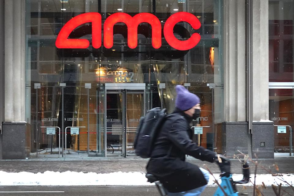 CHICAGO, ILLINOIS - JANUARY 27: A sign hangs in front of an AMC theater on January 27, 2021 in Chicago, Illinois. Shares of AMC Entertainment more than quadrupled today as investors continue their buying spree on heavily shorted stocks. (Photo by Scott Olson/Getty Images)