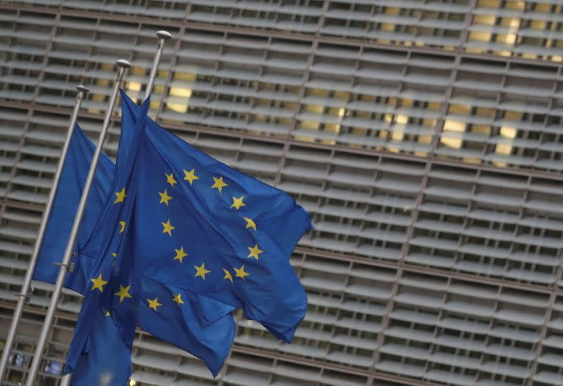 EU flags flutter outside the European Commission headquarters in Brussels