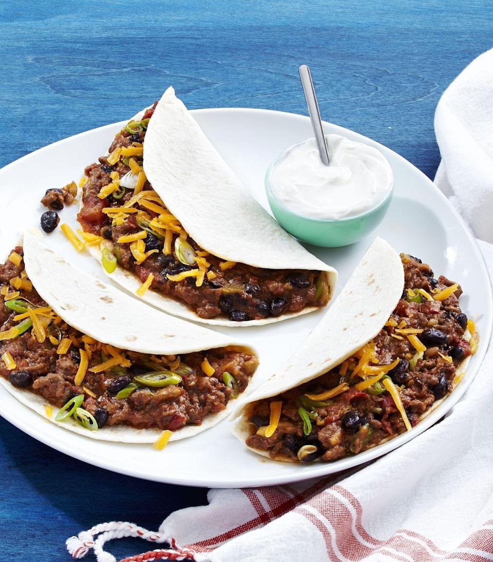 """<p>Celebrate taco Tuesday EVERY DAY.</p><p>Get the recipe from <a href=""""https://www.delish.com/cooking/recipe-ideas/recipes/a46606/cheesy-ground-beef-tacos-recipe/"""" rel=""""nofollow noopener"""" target=""""_blank"""" data-ylk=""""slk:Delish."""" class=""""link rapid-noclick-resp"""">Delish.</a></p>"""