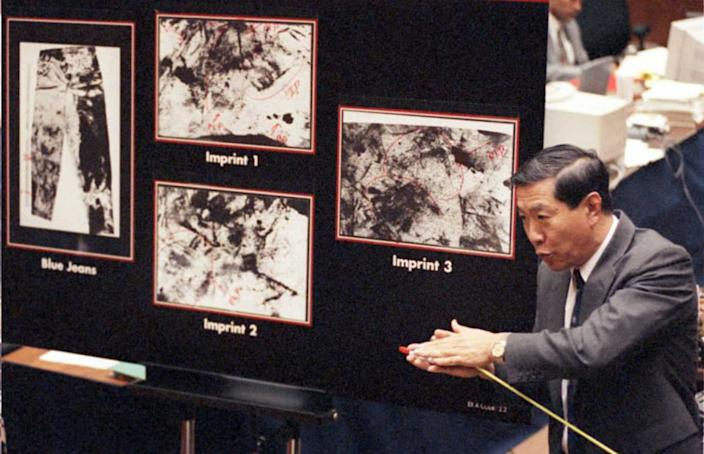 """<div class=""""inline-image__caption""""><p>Henry Lee explains to the jury possible shoe imprints on murder victim Ron Goldman's blood-stained jeans during direct examination by defense attorney Barry Scheck in the O.J. Simpson trial. The defense was trying to prove that the imprints were from a second assailant.</p></div> <div class=""""inline-image__credit"""">Getty</div>"""