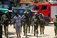 Officers patrol outside a police station in the Kenyan city of Mombasa in September, 2016 after an attempted terror attack (AFP Photo/)