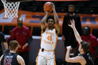 FILE - In this Dec. 21, 2020, file photo, Tennessee's Keon Johnson (45) shoots as St. Joseph's Ryan Daly, right, defends during an NCAA college basketball game in Knoxville, Tenn. Johnson played one season with the Volunteers and is one of the top shooting guards in the NBA draft. (Saul Young/Knoxville News Sentinel via AP, Pool, File)