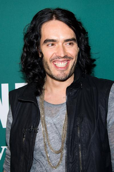"""FILE - In this Oct. 13, 2010 file photo, actor Russell Brand appears at a book signing for his memoir """"My Booky Wook 2"""" at Barnes & Noble in New York. Police in New Orleans have issued an arrest warrant Tuesday, March 15, 2012, for Brand, who is in the city to film an untitled movie. He faces a charge of simple criminal damage to property valued at $700. The incident happened on Monday, March 12, 2012, and involved a confrontation with a photographer who was trying to take Brand's photo from a car. (AP Photo/Charles Sykes, file)"""