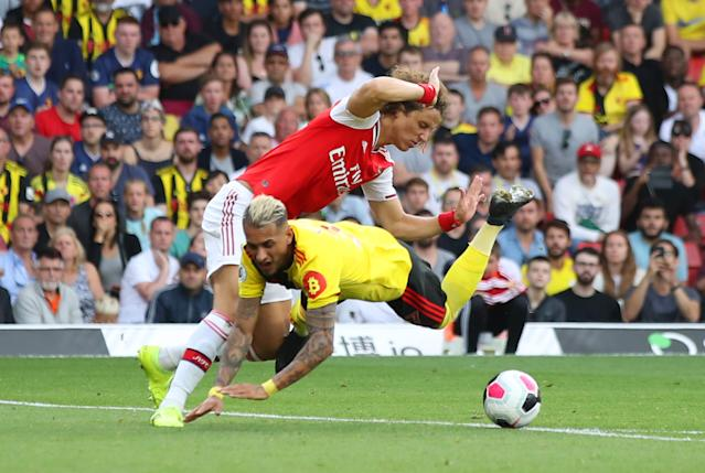 Roberto Pereyra is fouled by David Luiz. (Photo by Marc Atkins/Getty Images)