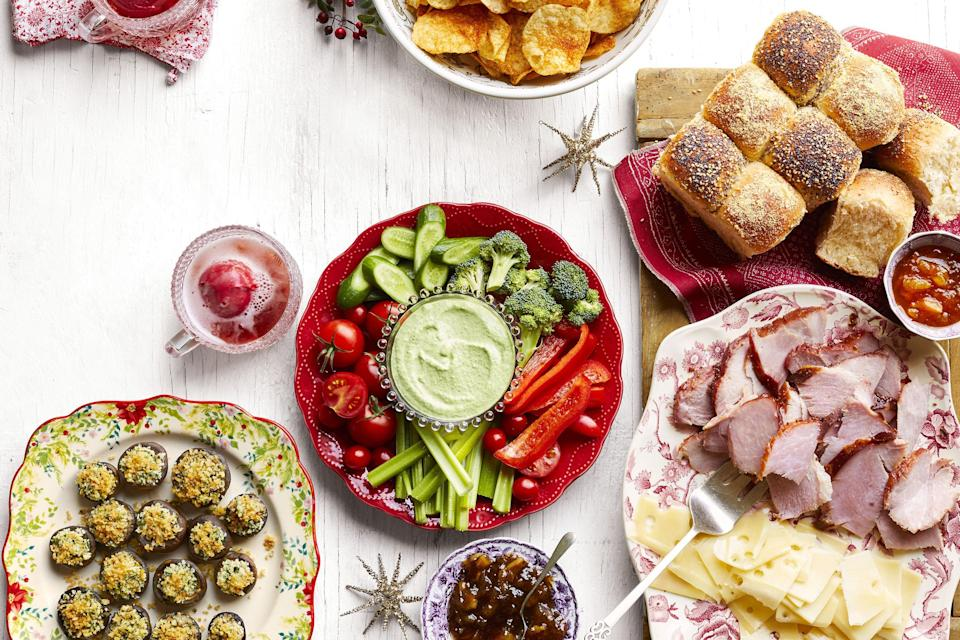 """<p>There are several items that every <a href=""""https://www.thepioneerwoman.com/food-cooking/meals-menus/g34197247/christmas-dinner-menu/"""" rel=""""nofollow noopener"""" target=""""_blank"""" data-ylk=""""slk:Christmas dinner menu"""" class=""""link rapid-noclick-resp"""">Christmas dinner menu</a> and <a href=""""https://www.thepioneerwoman.com/food-cooking/meals-menus/g34535328/christmas-eve-dinner-ideas/"""" rel=""""nofollow noopener"""" target=""""_blank"""" data-ylk=""""slk:Christmas Eve dinner menu"""" class=""""link rapid-noclick-resp"""">Christmas Eve dinner menu</a> absolutely must have. There are the tasty side dishes and the mind-boggling array of <a href=""""https://www.thepioneerwoman.com/food-cooking/meals-menus/g34127696/christmas-cookie-recipes/"""" rel=""""nofollow noopener"""" target=""""_blank"""" data-ylk=""""slk:Christmas cookies"""" class=""""link rapid-noclick-resp"""">Christmas cookies</a>, of course. Maybe a warm, cozy mulled drink like cider or wine too. But the part of the holiday feast that everyone is most excited for are the absolutely delicious Christmas appetizers. There's something so festive about serving beautiful trays of savory snacks that everyone will enjoy. In Christmases past, Ree Drummond hosted a holiday open house each year for friends and family where she made some of these delicious bites. """"I'll put out a big ham and all the fixings, plus easy snacks for a crowd,"""" she says. While you'll have to either scrap or modify your <a href=""""https://www.thepioneerwoman.com/holidays-celebrations/g32392394/christmas-party-ideas/"""" rel=""""nofollow noopener"""" target=""""_blank"""" data-ylk=""""slk:Christmas party ideas"""" class=""""link rapid-noclick-resp"""">Christmas party ideas</a> this year, there's nothing stopping you from making a feast of fun Christmas party food for your family to munch on.</p><p>For Christmas snacks that you can whip up in a flash, check out the fried goat cheese or the fig and blue cheese bruschetta. Both look impressive, but they won't take you longer than 25 minutes to make. There are also holiday favorites like"""