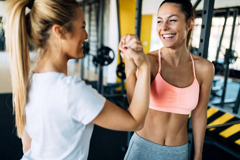 two fitness women in gym