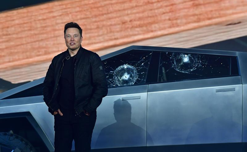 Tesla co-founder and CEO Elon Musk stands in front of the shattered windows of the newly unveiled all-electric battery-powered Tesla's Cybertruck at Tesla Design Center in Hawthorne, California on November 21, 2019. (Photo by FREDERIC J. BROWN / AFP) (Photo by FREDERIC J. BROWN/AFP via Getty Images)