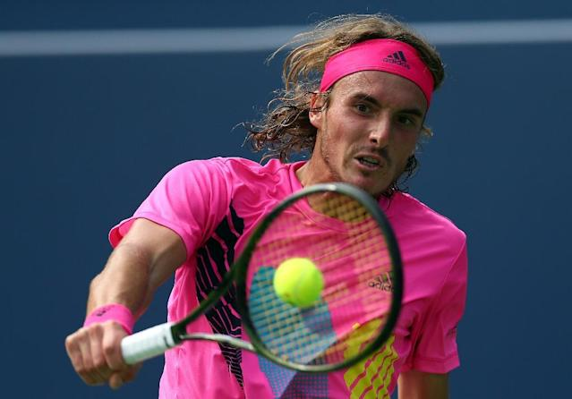 Greek chic: Stefanos Tsitsipas on his way to victory over Novak Djokovic (AFP Photo/Vaughn Ridley)