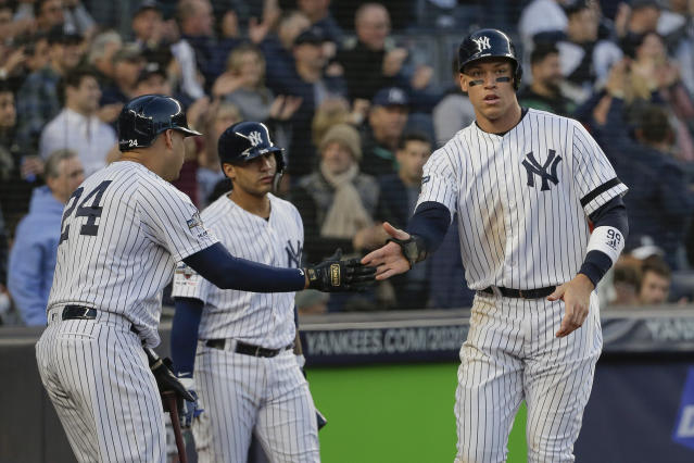 New York Yankees' Aaron Judge, right, celebrates with teammates after scoring against the Minnesota Twins during the third inning of Game 2 of an American League Division Series baseball game, Saturday, Oct. 5, 2019, in New York. (AP Photo/Seth Wenig)