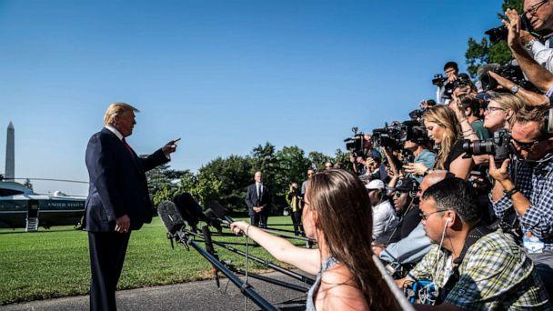 PHOTO: In this July 30, 2019, file photo, President Donald Trump stops to talk to reporters and members of the media as he walks to board Marine One and depart from the South Lawn at the White House in Washington, DC. (Jabin Botsford/The Washington Post via Getty Images, FILE)