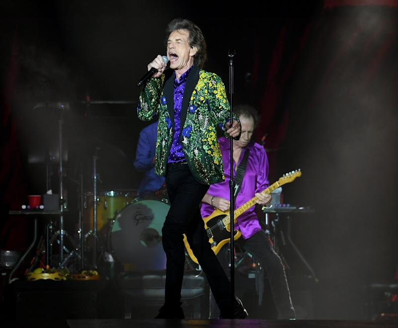 Mick Jagger (L) and Keith Richards of The Rolling Stones perform onstage at Rose Bowl. A small Martian rock has been named in the band's honor.