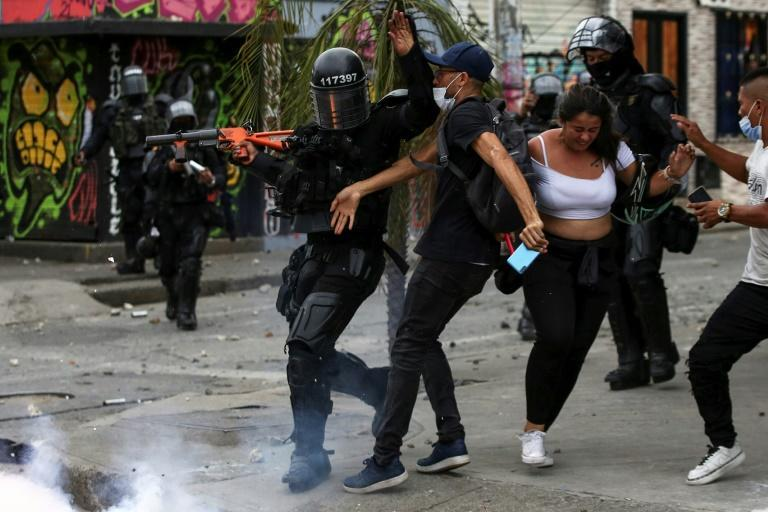 Demonstrators clash with riot police during a protest against the government of Colombian President Ivan Duque in Cali