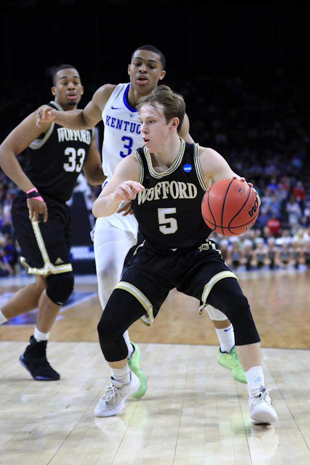 <p>Storm Murphy #5 of the Wofford Terriers drives against Keldon Johnson #3 of the Kentucky Wildcats during the first half of the game in the second round of the 2019 NCAA Men's Basketball Tournament at Vystar Memorial Arena on March 23, 2019 in Jacksonville, Florida. (Photo by Mike Ehrmann/Getty Images) </p>