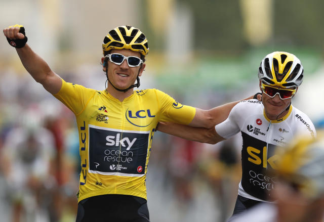 Tour de France winner Britain's Geraint Thomas, left, wearing the overall leader's yellow jersey reacts with Britain's Chris Froome on the Champs Elysees avenue after the twenty-first stage of the Tour de France cycling race over 116 kilometers (72.1 miles) with start in Houilles and finish on Champs-Elysees avenue in Paris, France, Sunday July 29, 2018. (AP Photo/Laurent Rebours)