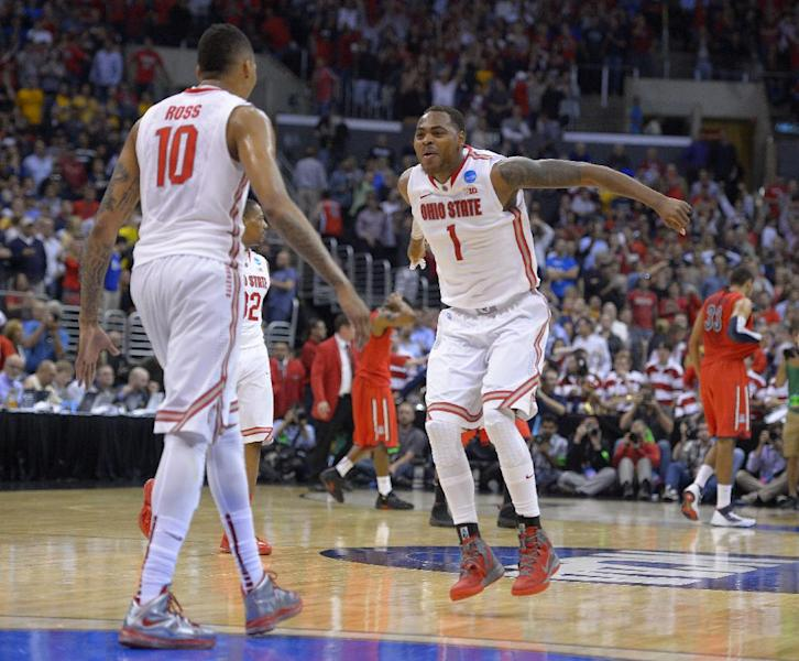 Ohio State's LaQuinton Ross, left, and Deshaun Thomas celebrate the team's 73-70 win over Arizona in a West Regional semifinal in the NCAA men's college basketball tournament, Thursday, March 28, 2013, in Los Angeles. (AP Photo/Mark J. Terrill)