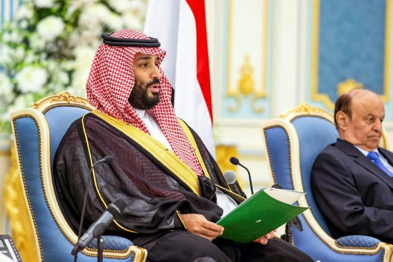 """Saudi Crown Prince Mohammed bin Salman (L) is reported to be """"Royal Family Member-1,"""" who is mentioned in a US indictment over an alleged plot to use Twitter data to spy on dissidents (AFP Photo/Bandar AL-JALOUD)"""
