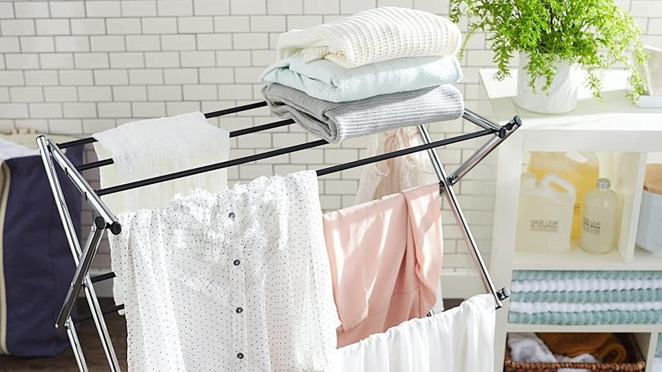 Air dry your clothes on this sturdy laundry rack.