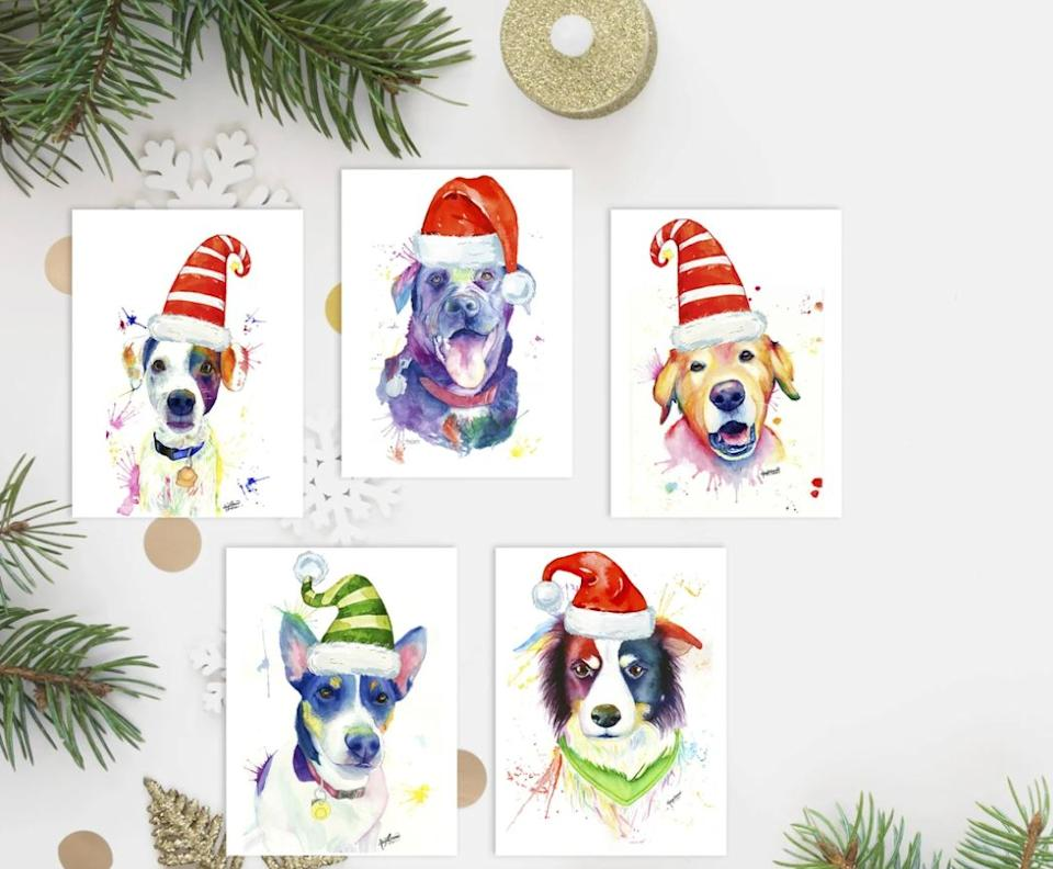 "(Photo: <a href=""https://shop.belocal.org/products/5-pack-xmas-dogs"" target=""_blank"">Maya Corona Art and Design</a>)"