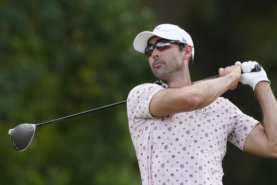 Cameron Tringale watches his drive from the third tee during the final round of the Sanderson Farms Championship golf tournament in Jackson, Miss., Sunday, Oct. 3, 2021. (AP Photo/Rogelio V. Solis)