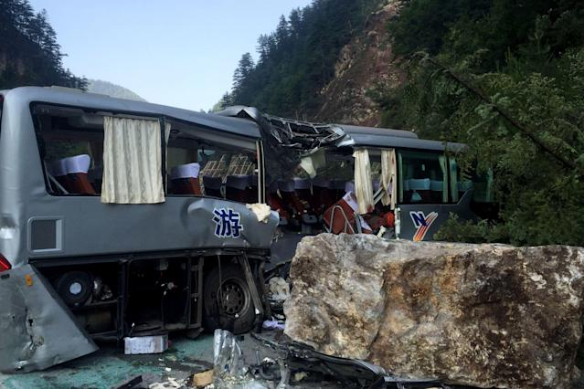 <p>A tour bus damaged during an earthquake is seen in Jiuzhaigou in China's southwestern Sichuan province on Aug. 9, 2017. (Photo: STR/AFP/Getty Images) </p>