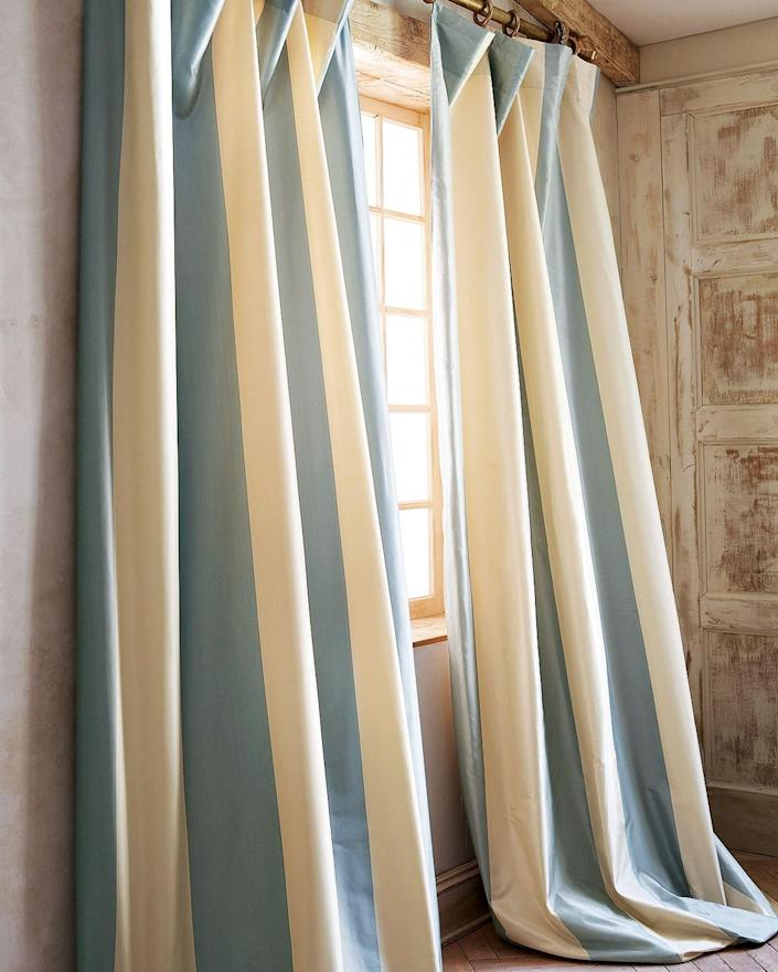 "Super-wide silk stripes (lined with cotton) make for a bold statement in just about any living room—no matter the style. Go demure in a charcoal gray or big in a ballet pink. Either way, these elegant curtain panels will serve as the perfect finishing touch. $345, Horchow. <a href=""https://www.horchow.com/Home-Silks-Each-Hampton-Curtain-108-L/cprod131140215/p.prod?"" rel=""nofollow noopener"" target=""_blank"" data-ylk=""slk:Get it now!"" class=""link rapid-noclick-resp"">Get it now!</a>"