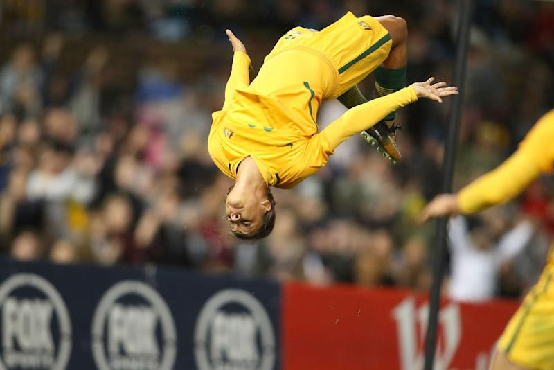 Australia soccer player Sam Kerr doing a backflip in celebration.