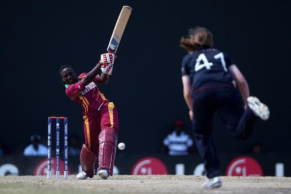 Stefanie Taylor (l) of West Indies hits out off the bowling of Anya Shrubsole during the ICC T20 Women's World Cup Group A match between West Indies and England.