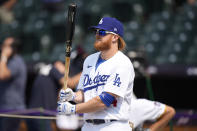National League's Justin Turner, of the Dodgers warms-up during batting practice for the MLB All-Star baseball game, Monday, July 12, 2021, in Denver. (AP Photo/David Zalubowski)