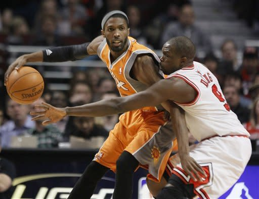 Phoenix Suns forward Hakim Warrick (21) posts up against Chicago Bulls forward Luol Deng (9) during the first half of an NBA basketball game Tuesday, Jan. 17, 2012, in Chicago. (AP Photo/Charles Rex Arbogast)