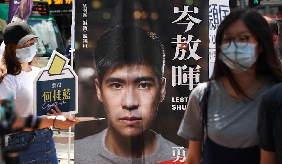 A poster featuring Lester Shum is seen outside a polling station during pan-democrats' primary elections in July. Photo: Felix Wong