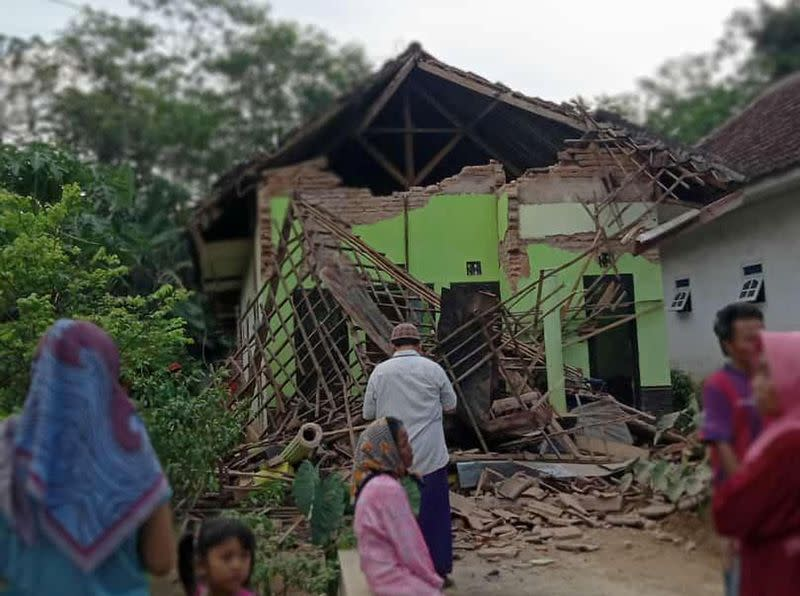Damaged house affected by an earthquake is pictured in Malang